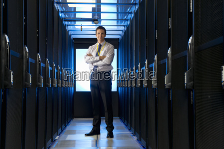 manager standing in aisle of storage
