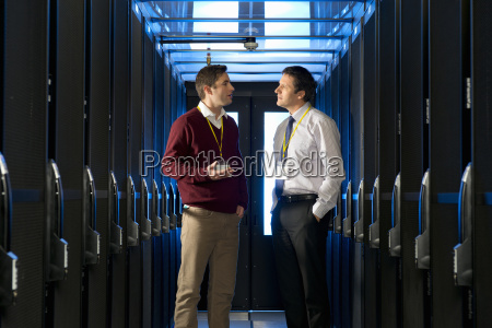 manager and technician talking in aisle