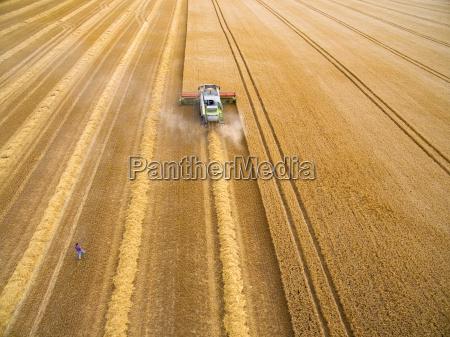 aerial view of farmer walking toward