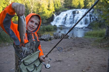 keegan pietila shows off a fish