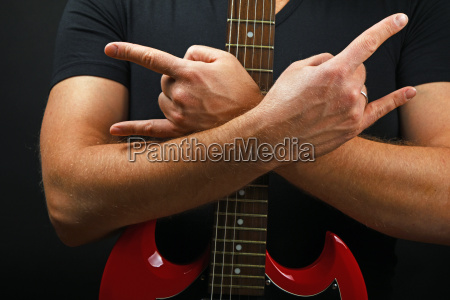 hands with red guitar and devil