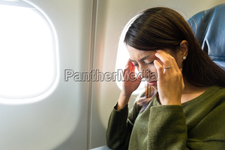 woman in plane suffer from airsick