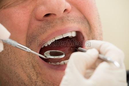 man examined by dentist
