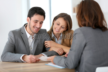 couple meeting financial adviser for construction