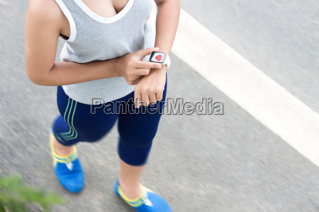 sport woman use digital hand watch
