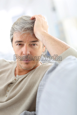 portrait of attractive mature man relaxing