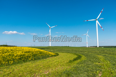 fields with wind turbines in germany