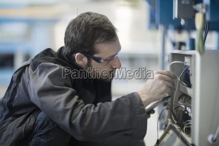 ritratto occhiali abiti da lavoro fabbrica