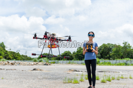 woman control the drone
