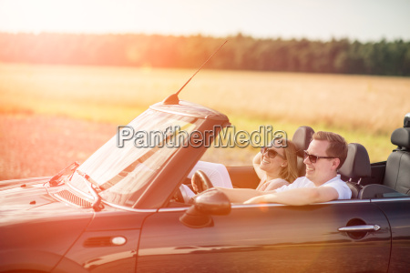 couple in the car in sunshine