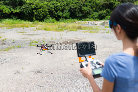woman control with drone at outdoor