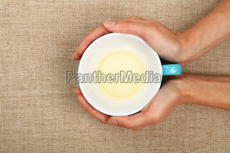 two woman hands holding cup of
