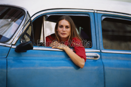 woman sitting in the drivers seat