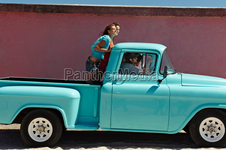 5 young people traveling in pickup