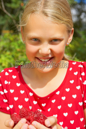 young girl outdoors smiling