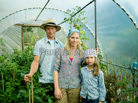 a family in a green house