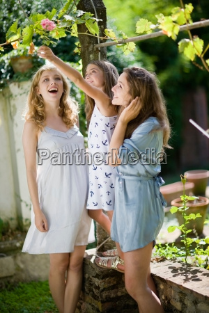 three girls in the green garden