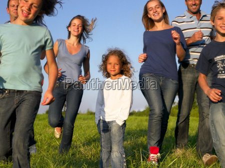 group of people and children running
