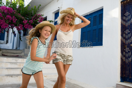 woman and young girl running outside