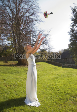a bride throwing her bouquet of