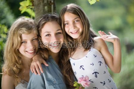 three girls hugging each other