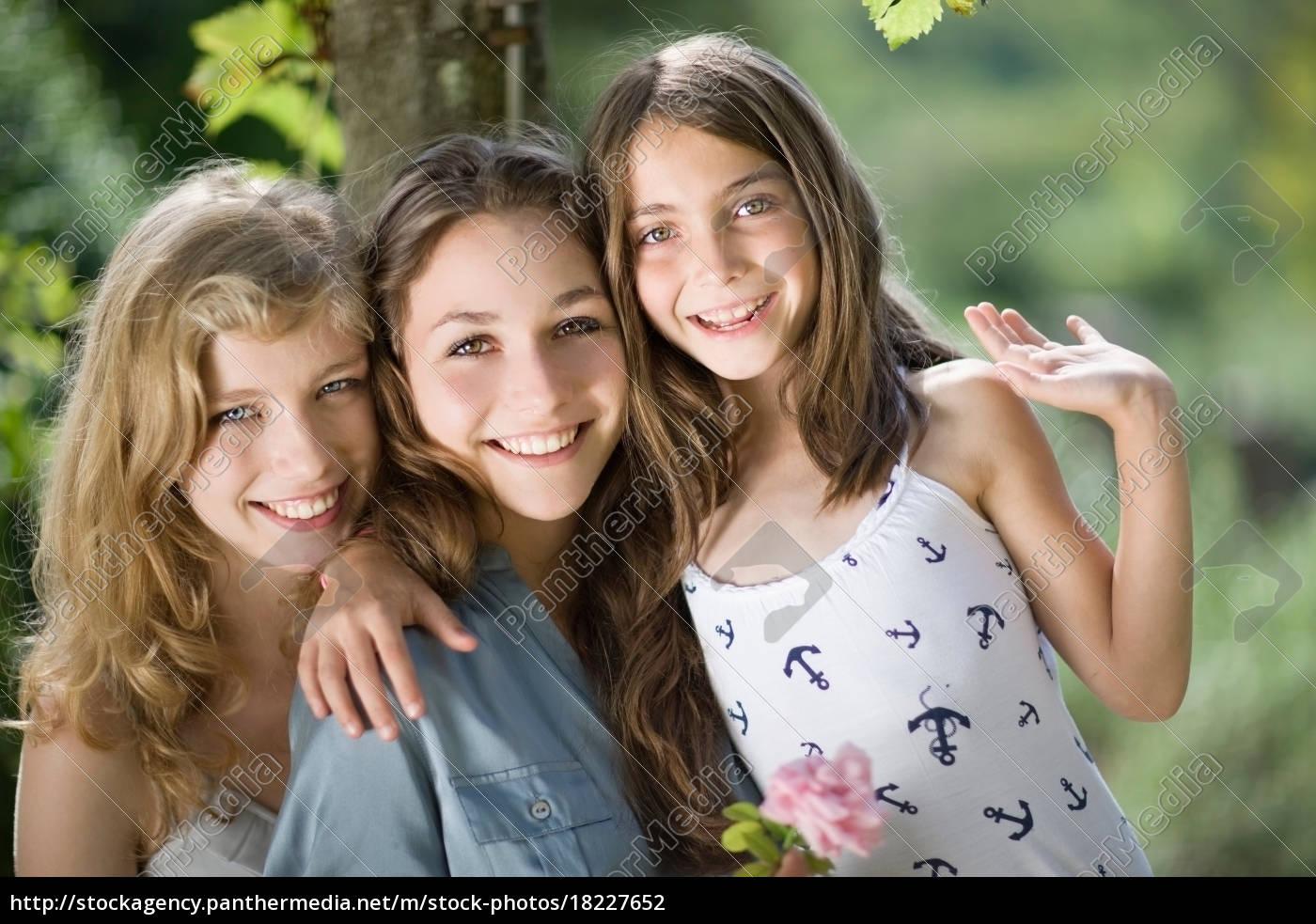 three, girls, hugging, each, other - 18227652