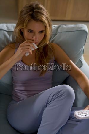 woman sitting watching tv