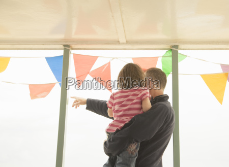 man with child looking out past