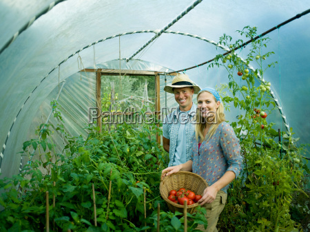 a couple in a green house