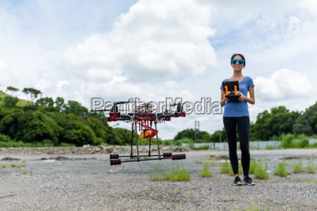 woman remote the drone