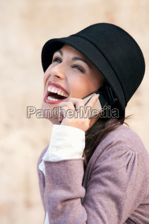 a, woman, laughing, on, a, mobile - 18251650