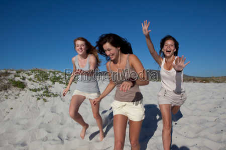 three girls running towards camera