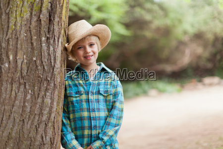 boy wearing cowboy hat outdoors