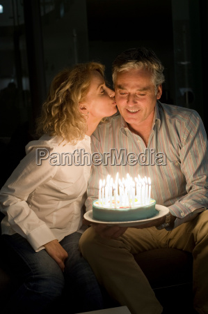 man and woman with cake
