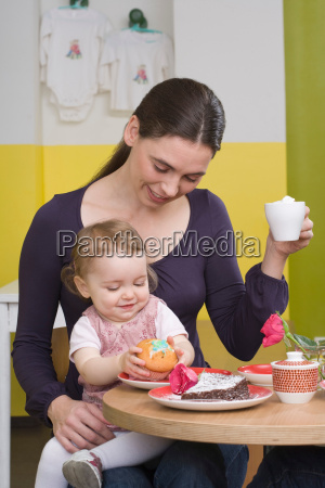 young girl with cake on