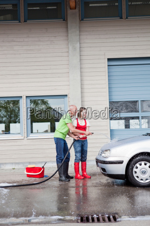 old man and young girl washing