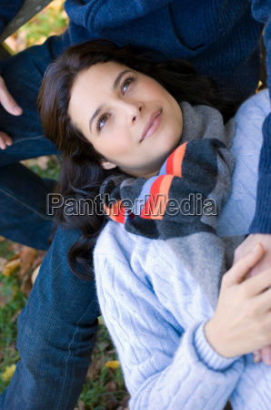 girl resting head on mans lap