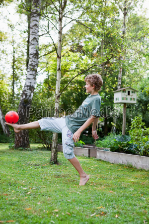 boy playing with ball in the