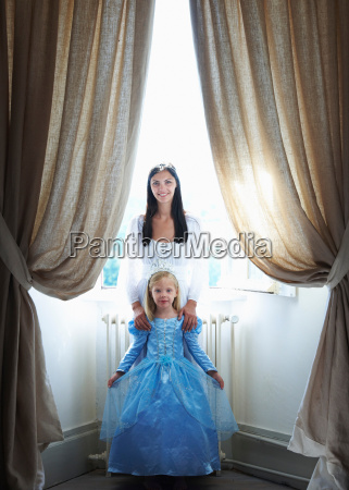 mother daughter dressed as princesses