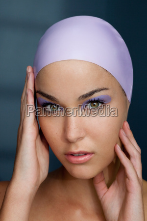 woman in swim cap with makeup