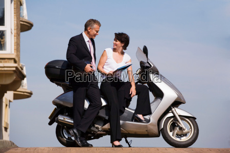 business people sitting on scooter