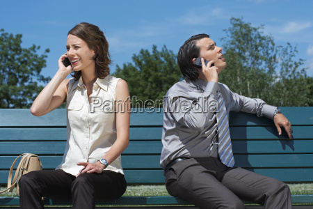 businessman and women talking on phone