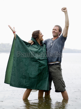 man and woman standing in shallow