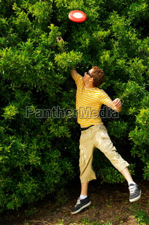 young man jumping to reach a