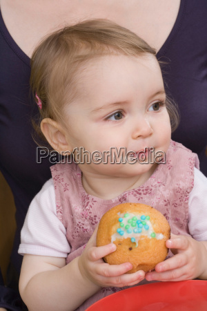 young girl with cake close