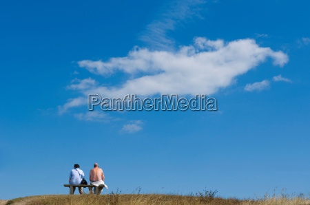 couple sitting looking to the distance