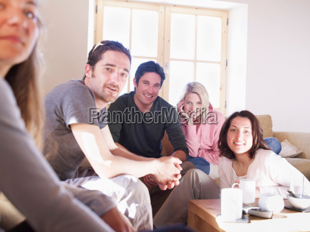 friends laughing in chalet living room