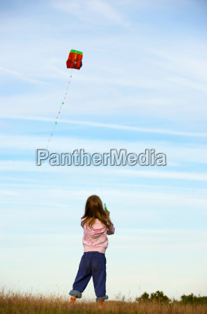 girl flying a kite in a