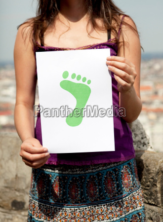 woman holding paper green foot