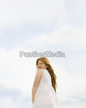 girl looking to camera set against
